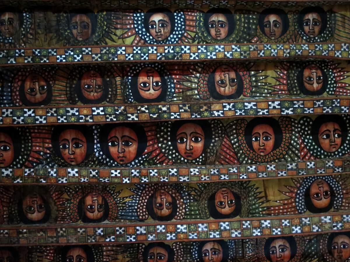 picture description: ceiling paintings, Debre Berhan Selassie Church, Gondar, culture and history with ZenAye Ethiopia Tours, Swiss-African expert in tour operation / photo: Linetta Schneller
