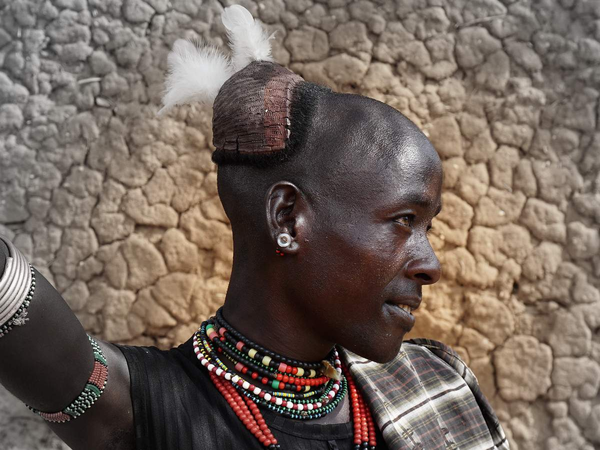 picture description: young Hamer, Lower Omo Valley, ethnic Tribal South with ZenAye Ethiopia , Swiss-African expert in tour operation / photo: Linetta Schneller